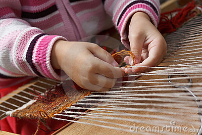 Child learns to weave