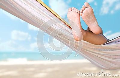 Child legs on hammock