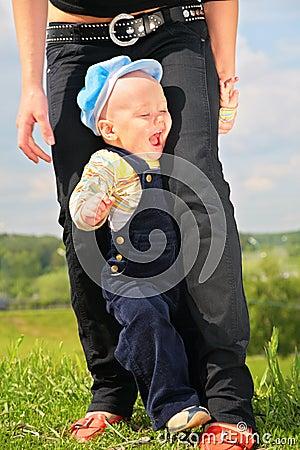 Child between legs of mother