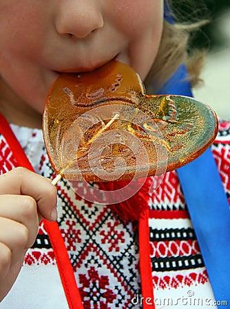 Child licks candy