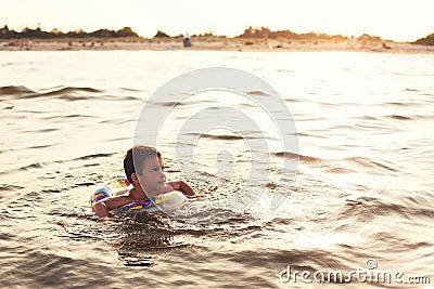 Child with lifebuoy