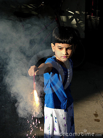 Child Lighting The Fire Cracker