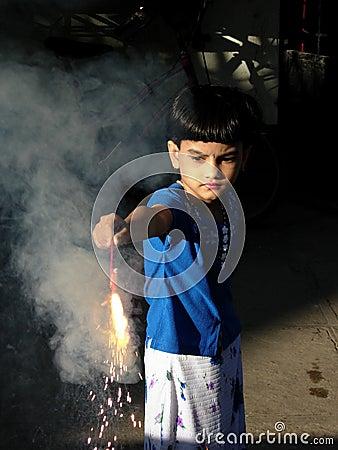 Child Lighting The Fire Cracker
