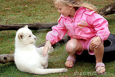 Child with lion cub