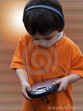Free Child Listening To Music - Orange Stock Images - 122224