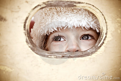 Child look out of hole