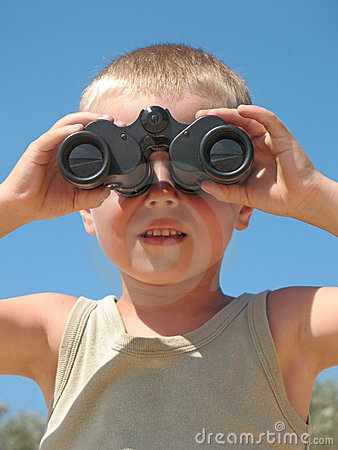 Child looking through binoculars