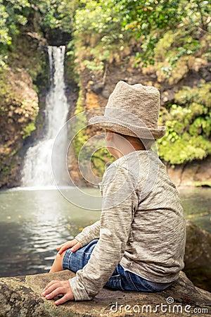 Free Child Looking Chamouze Waterfall. Mauritius Stock Photography - 82381042