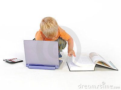 Child looking in a law book