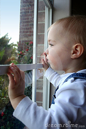 Free Child Looking Out Window Royalty Free Stock Photos - 4436148