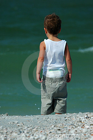 Child looking at surf