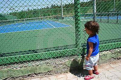 Child looking tennis court