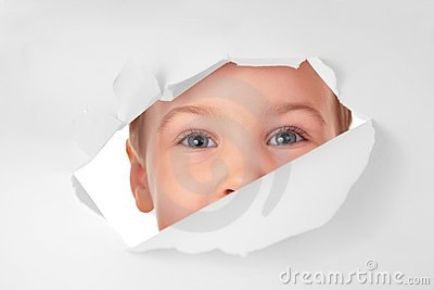 Child looks in hole in sheet of paper