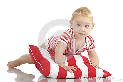 Child lying with pillow