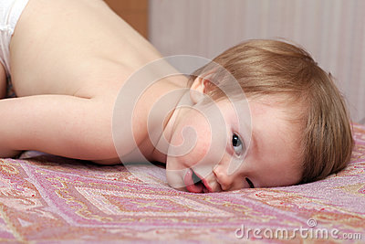 Child lying and staring