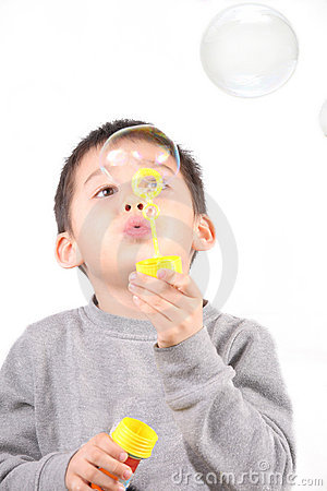 The child makes bubbles on white