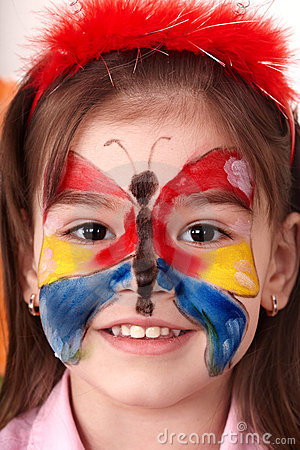 Child  making face painting.
