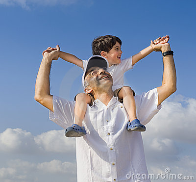 Child on man shoulders