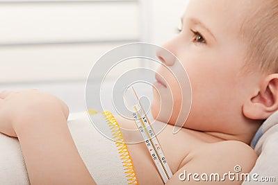Child measuring temperature