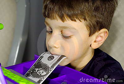 Child With Money in Mouth