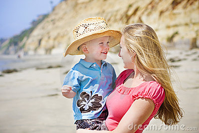 Child and Mother play at the beach together