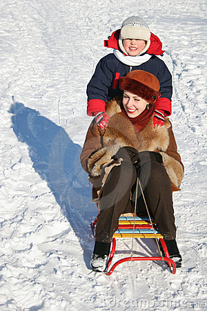 Child with mother on sled