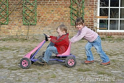 Child moves pedal car