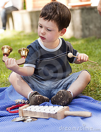 Child with musical instruments