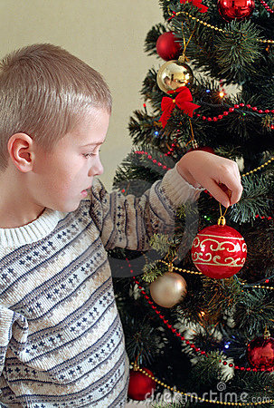 Child near christmas tree