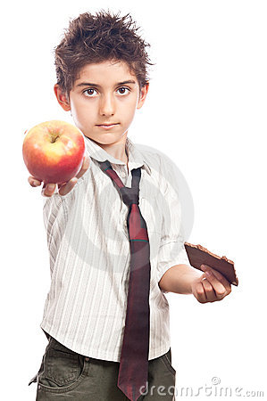 Child offering apple instead chocolate