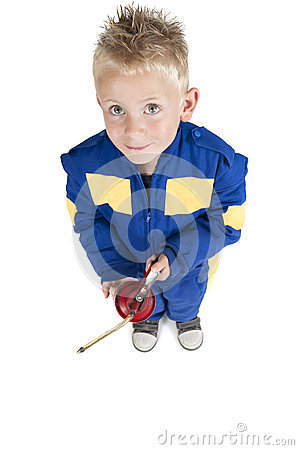 Child with oil pipette in coverall on white