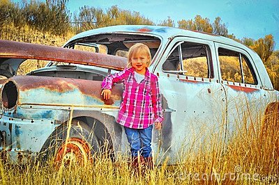 Child and Old car
