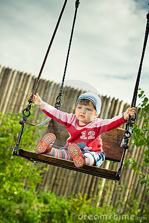 Free Child On The Swings Royalty Free Stock Image - 9503376