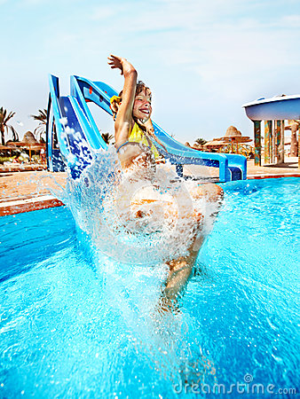 Free Child On Water Slide At Aquapark. Stock Photo - 28031670