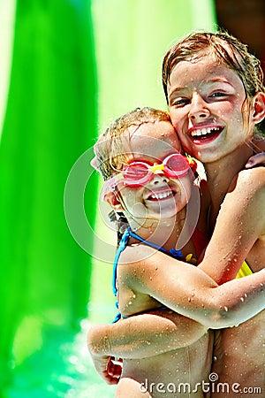 Free Child On Water Slide At Aquapark. Royalty Free Stock Photo - 30465285