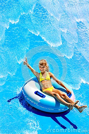 Free Child On Water Slide At Aquapark. Stock Photo - 30465450