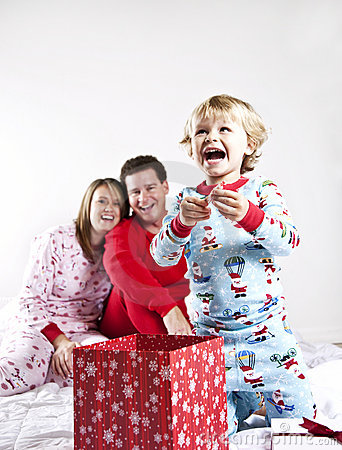 Child opening gifts on Christmas