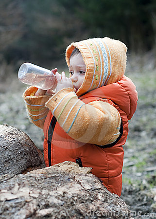 Child outdoors drinking
