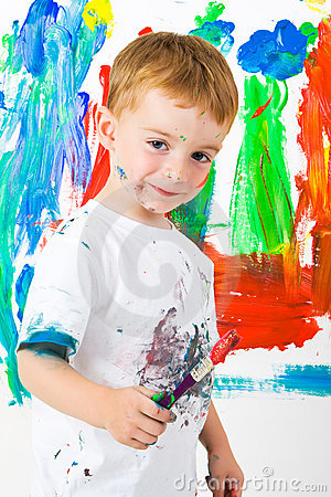 Child painting with a great expression