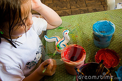 Child Painting Her Craft Project