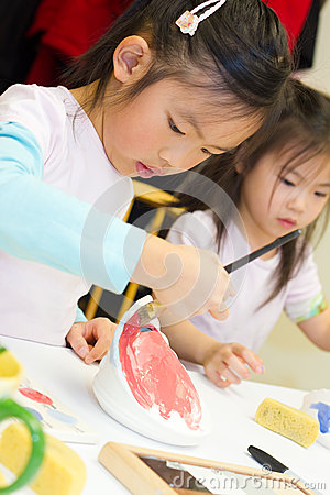 Child Painting Pottery Royalty Free Stock Images - Image: 29286949