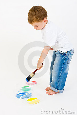 Child painting with primary colors