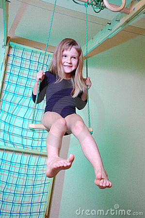 Child palying with home gym