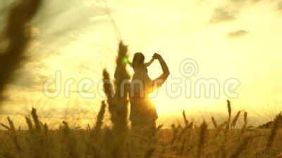 The child and parent play in nature. happy family and childhood concept. Slow motion. little daughter on father`s. Child and parent play in nature. happy family stock video
