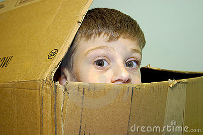 Child Peeking out of a Carton
