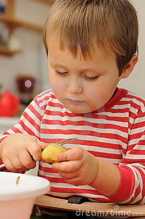 Child peeling potato