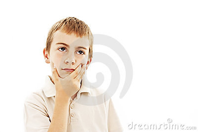 Child with a pensive expression looking up