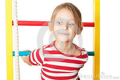 Child performs gymnastic exercise