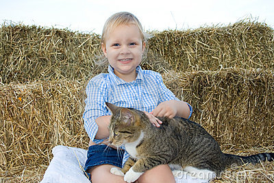Child with pet.