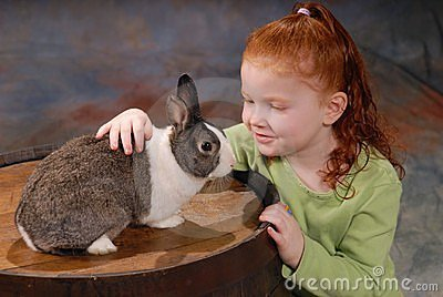 Child with Pet Rabbit